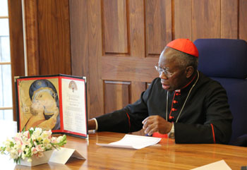 Cardinal Arinze presides over one of the discussions—the signed pledge of loyalty to his right.