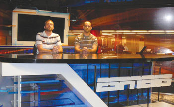 Alumnus Bryan Hadro (right) shows his brother Matt ('10) the set of ESPN News during a tour of his workplace.