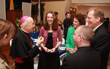 The Archbishop chats with College President Timothy O'Donnell, his wife Cathy, College Chaplain Fr. Donald Planty , and students.